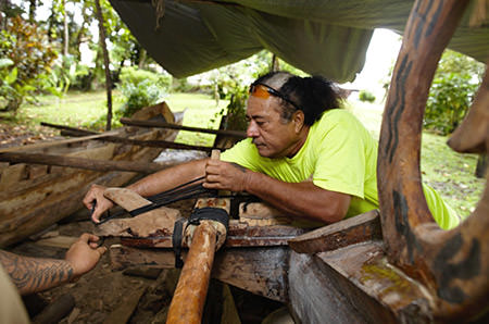 man building a traditional samoan canoe