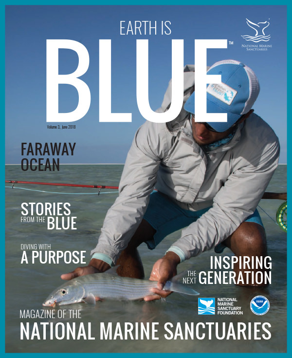 earth is blue magazine volume 3 cover - angler holding a fish