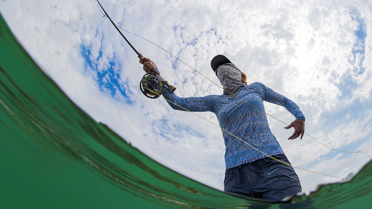 woman fly fishing