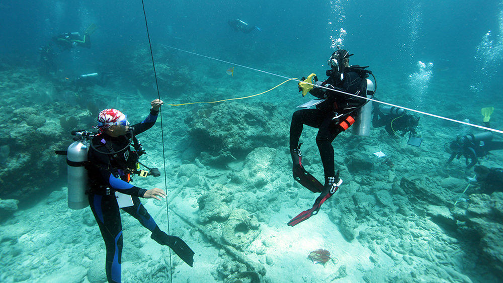 divers documenting shipwreck artifacts