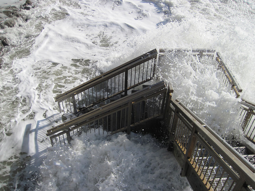 An especially high tide off Santa Barbara, California inundates a stairway to the beach.