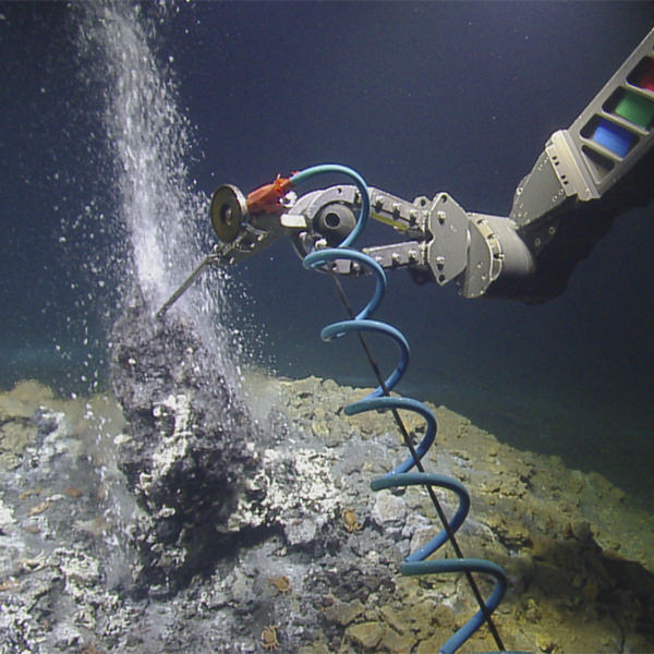 rov arm sampling from a seafloor vent