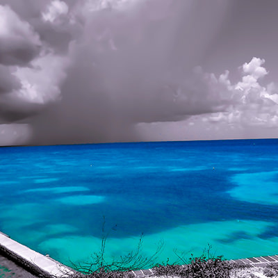bright blue water beneath gray skies