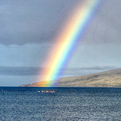 rainbow over outrigger canoers