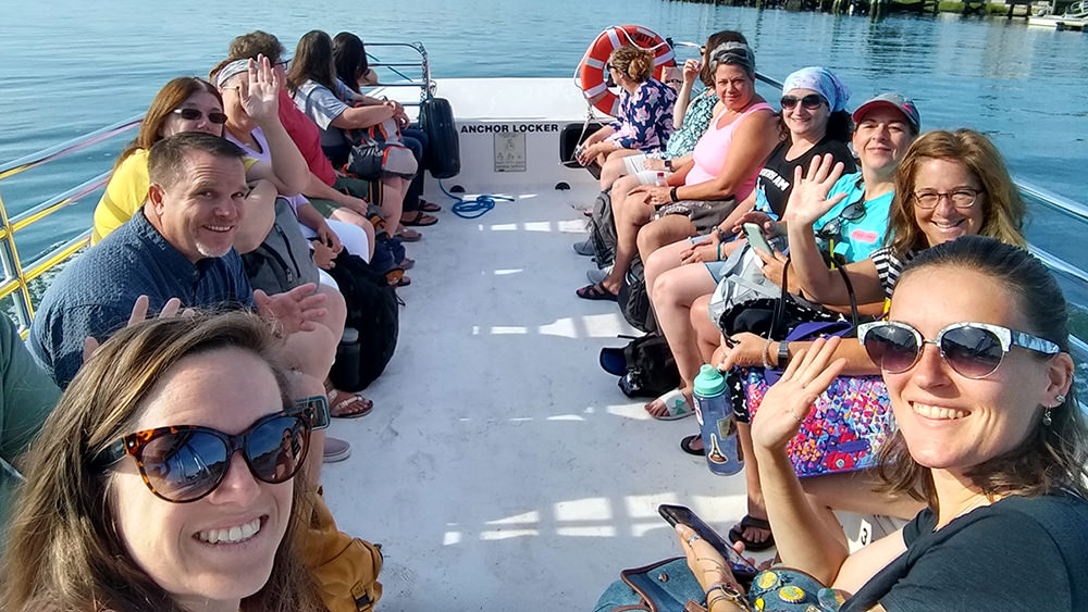 teachers gathered together on a small boat
