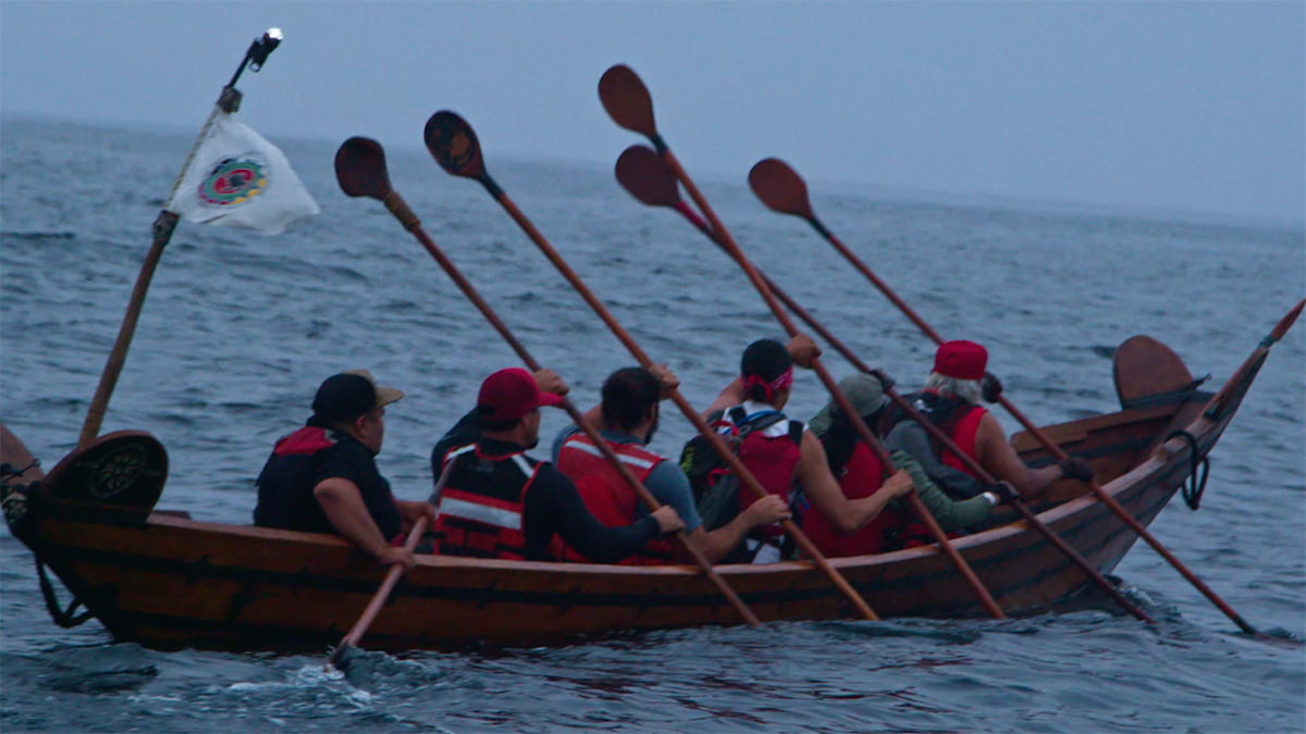 people paddling a traditional tomol
