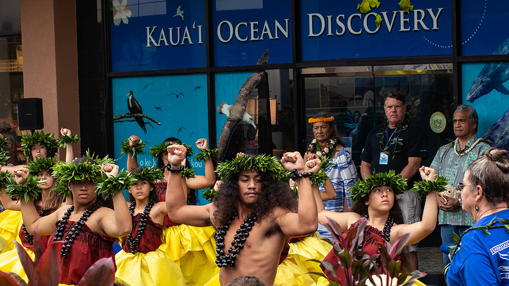 a group of people performing hula