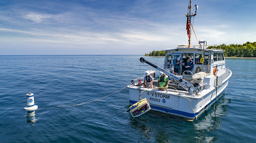 researchers on a boat in lake huron