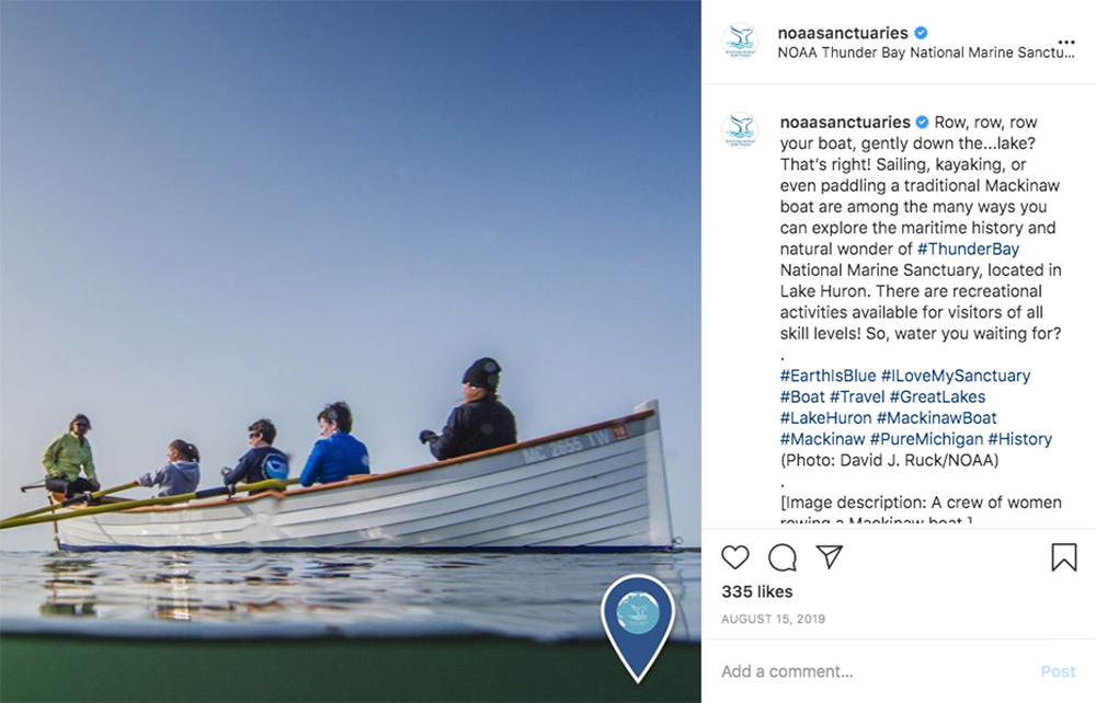 instagram post with a picture of people paddling a mackinaw boat