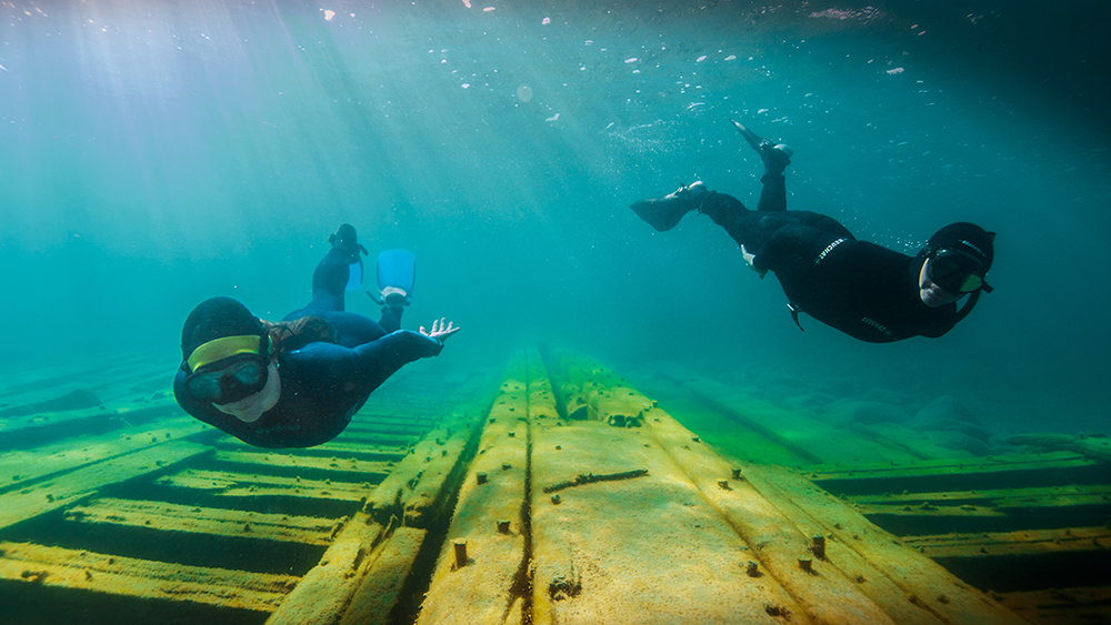 two snorkelers over a shipwreck
