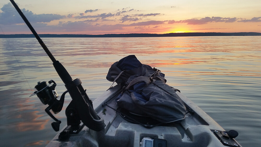 the view of a sunrise from a kayak