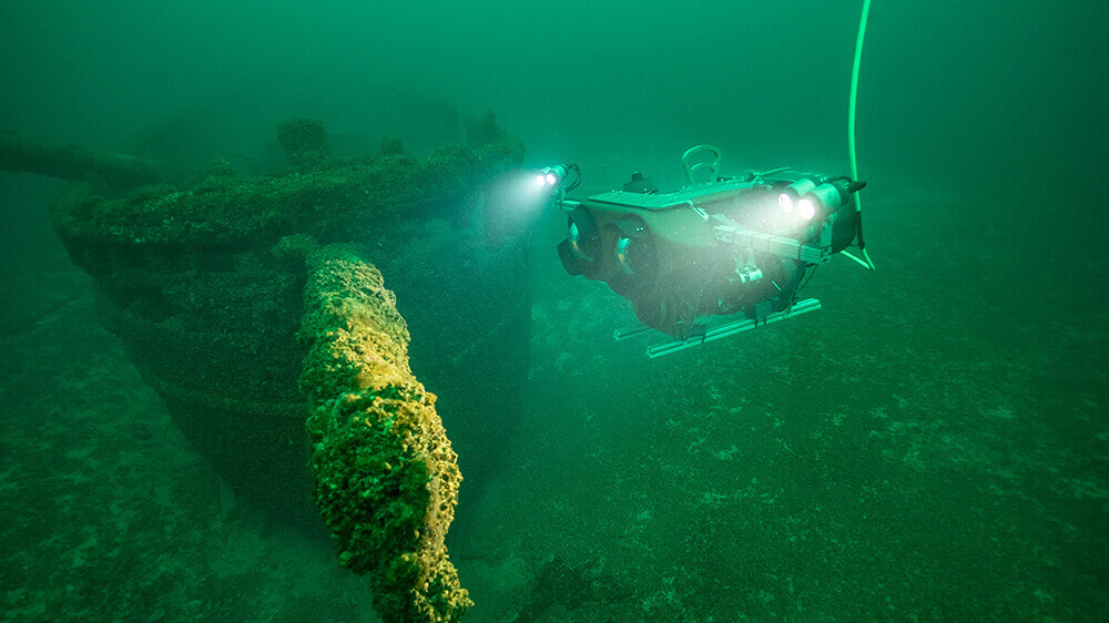 An rov inspects a shipwreck
