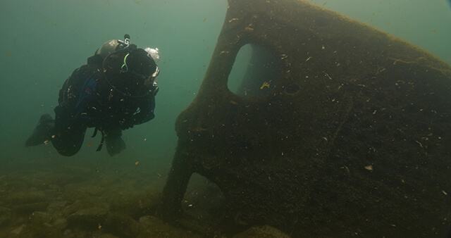 Diver swimming near shipwreck