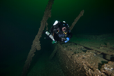 A diver swims near the wreck of The St.Peter