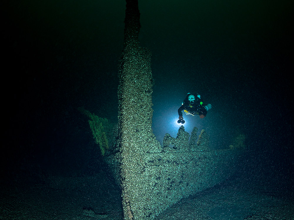 A diver inspects the bow of the suspected steamer Homer Warren