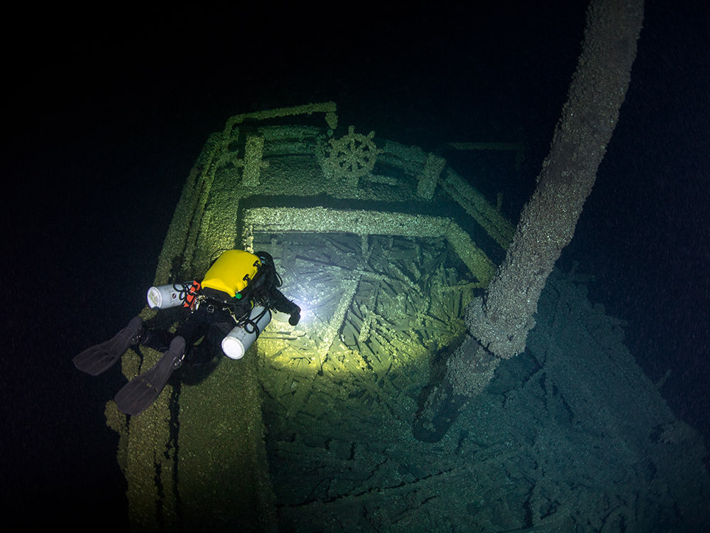 A diver explores the stern of Queen of the Lakes
