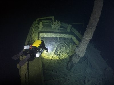 A diver inspects the stern of Queen of the Lakes