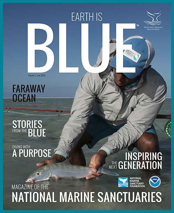 earth is blue magazine volume 3 cover - man holding a fish he caught