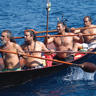 4 men paddling a tomol