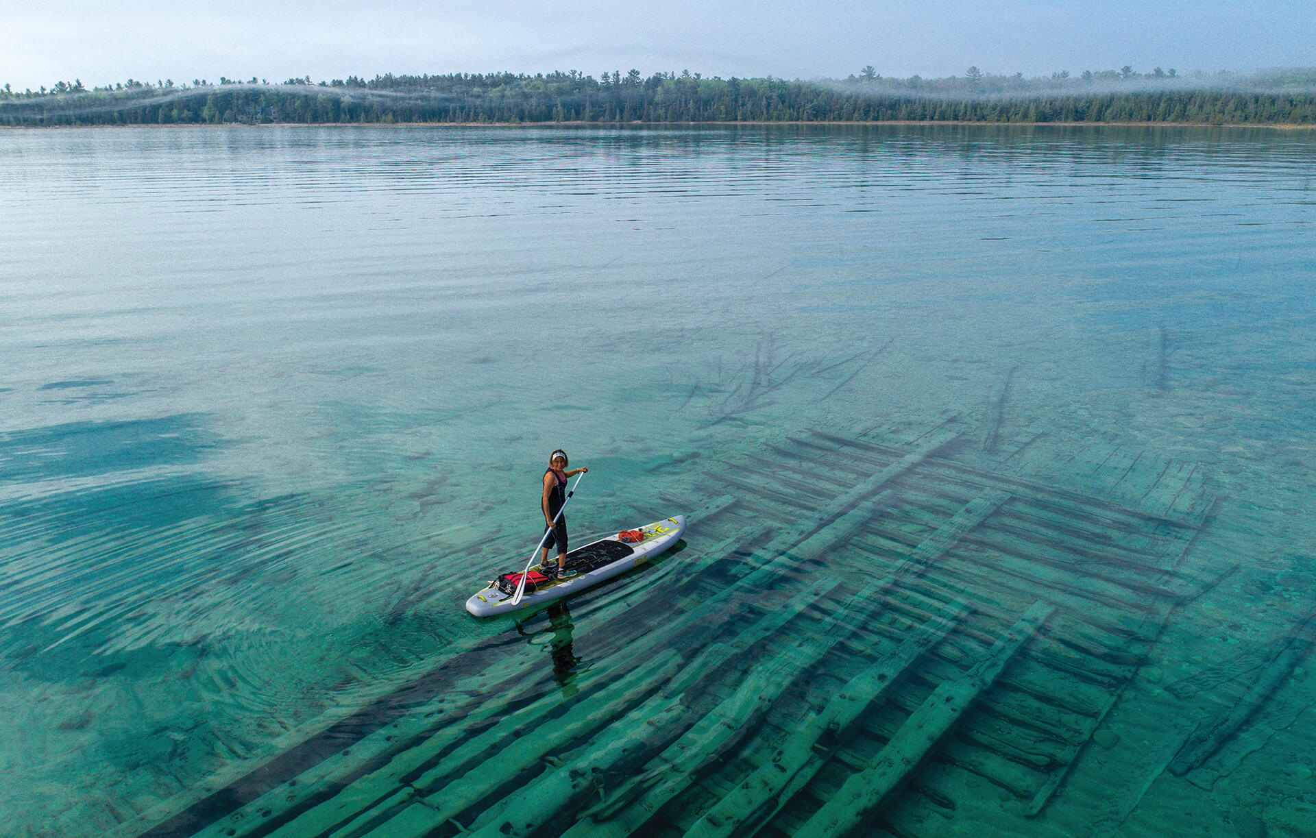 A stand up paddle boarder in Thunder Bay National Marine Sanctuary