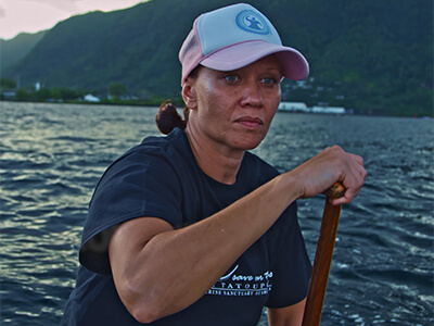 A woman rows a boat