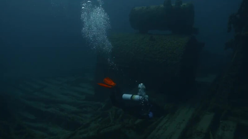 Diver inspects shipwreck